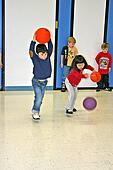 First Grade Mixed ethnic genders students in gym game at elementary ...