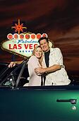 Couple in car by Las Vegas sign